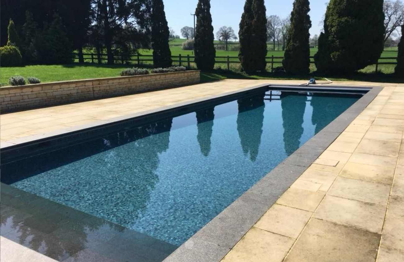 Outdoor Pool with neighbouring fields